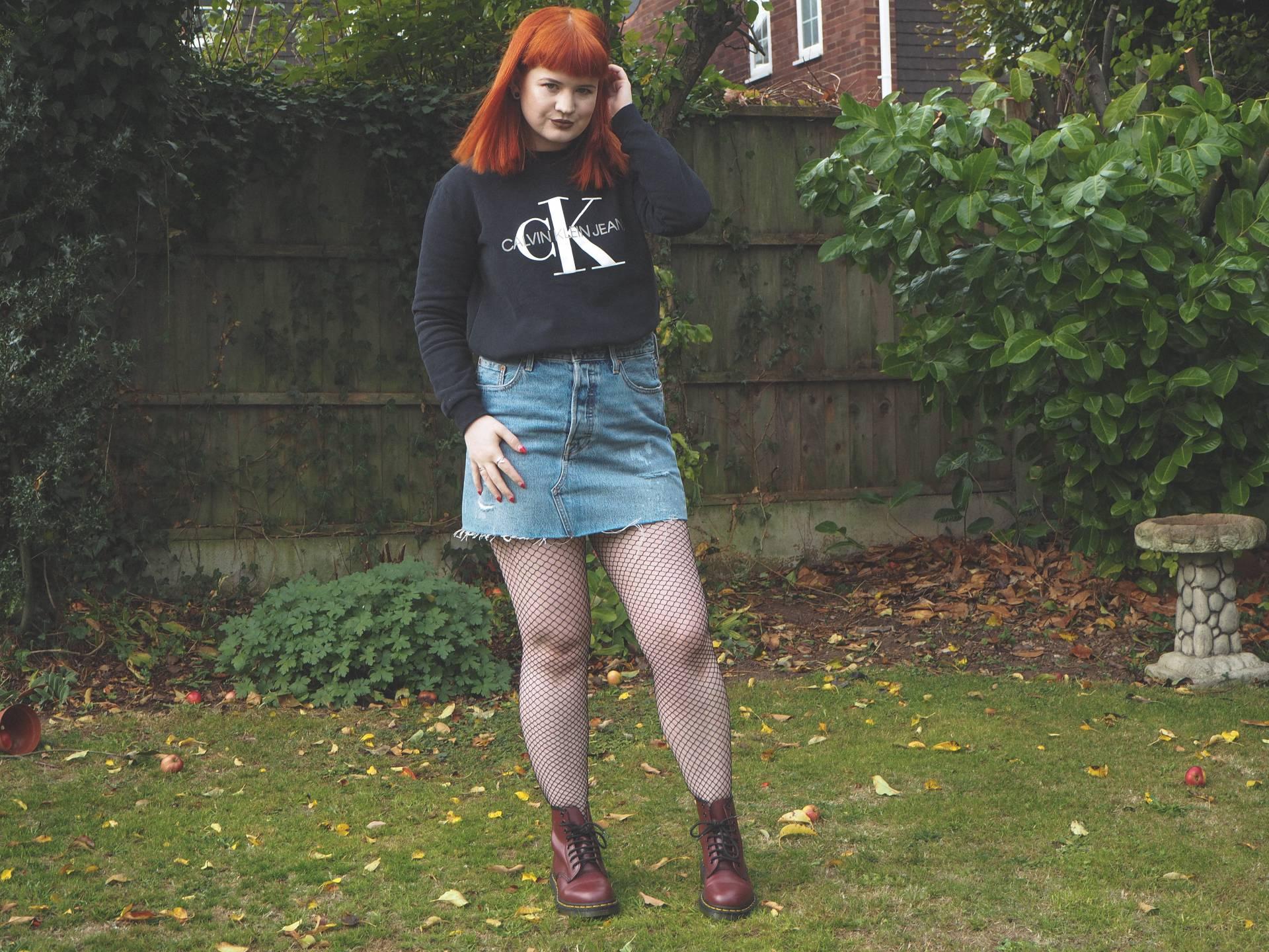 NA-KD fashion, Calvin Klein sweatshirt, Levi's, Dr Martens